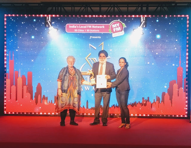 Mr. Karan Anand, Head Realtionships, Cox and Kings receiving the award-