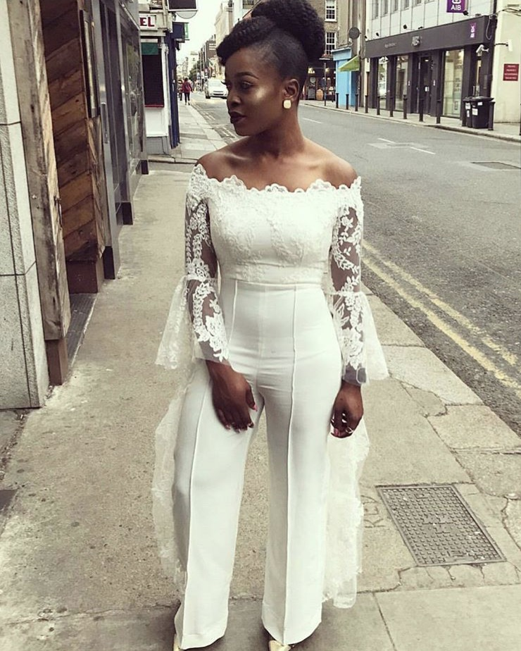 girl wearing white lace bell sleeve jumpsuit