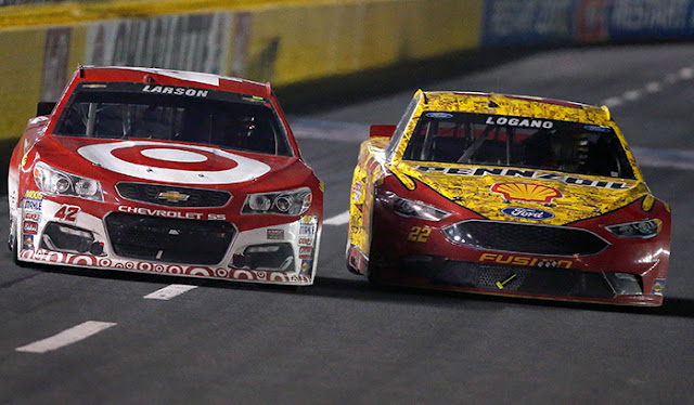Joey Logano and Kyle Larson battle it out.