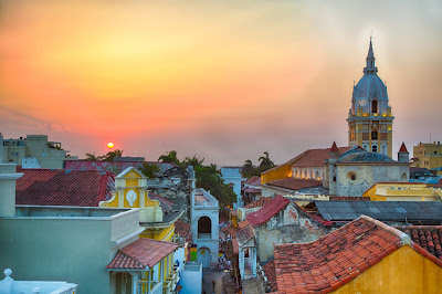 Image of sunset over colorful buildings in Cartegena, Columbia