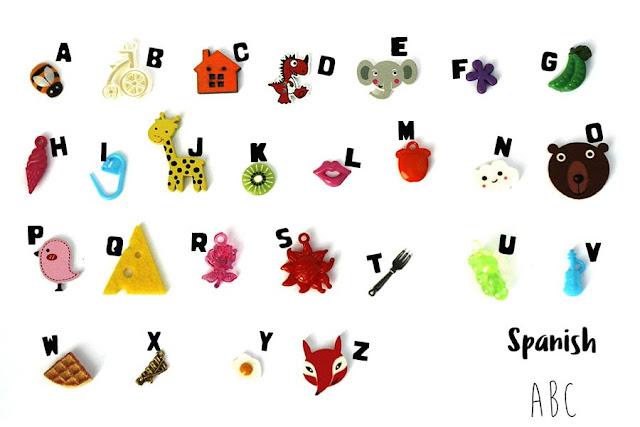 Multilingual ABC trinkets by TomToy, Spanish language, Alphabet box objects, Montessori language objects, A-Z phonics, multilanguage Spanish alphabet