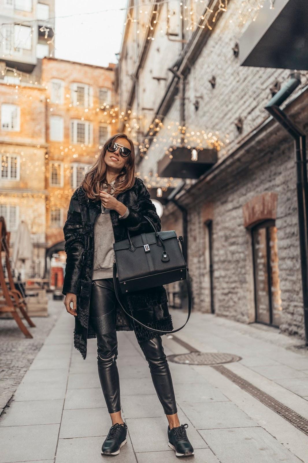 minimalist winter outfit fur coat sneakers hoodie