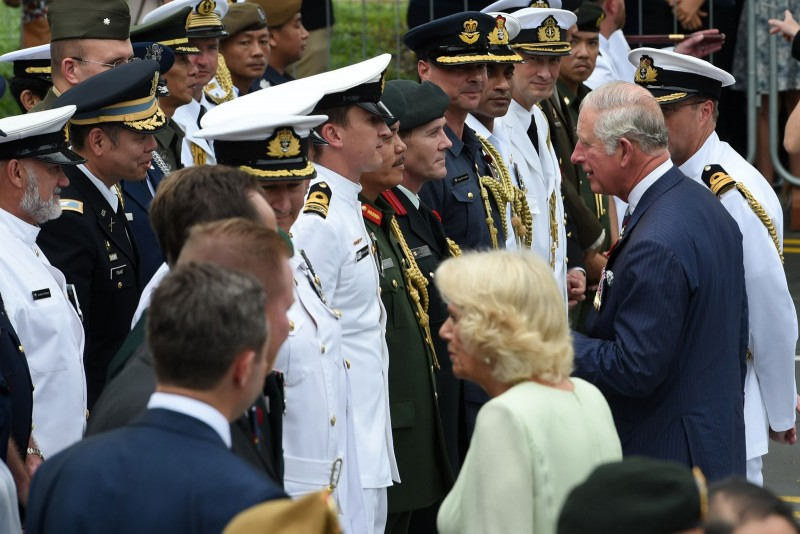 Britain's Prince Charles, Prince of Wales and Camilla, Duchess of Cornwall talk to Commonwealth war veterans during a wreath laying ceremony at The Cenotaph war memorial in Singapore on October 31, 2017.
