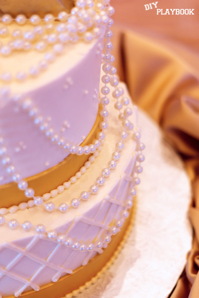 The pearls on this wedding cake are elegant and classic.