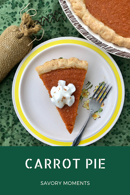 A slice of carrot pie with whipped cream on top.