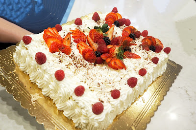 Italian Wedding cake topped with cream and fruit