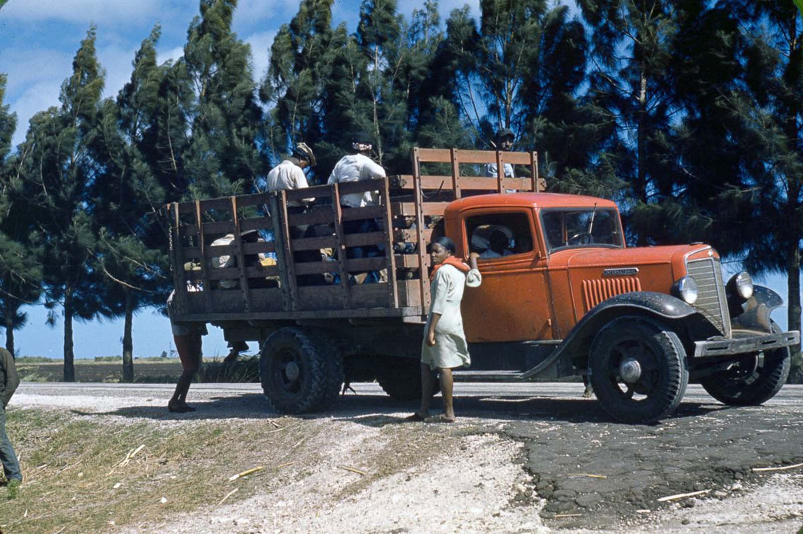Workers board a truck in Mississippi. 1940.