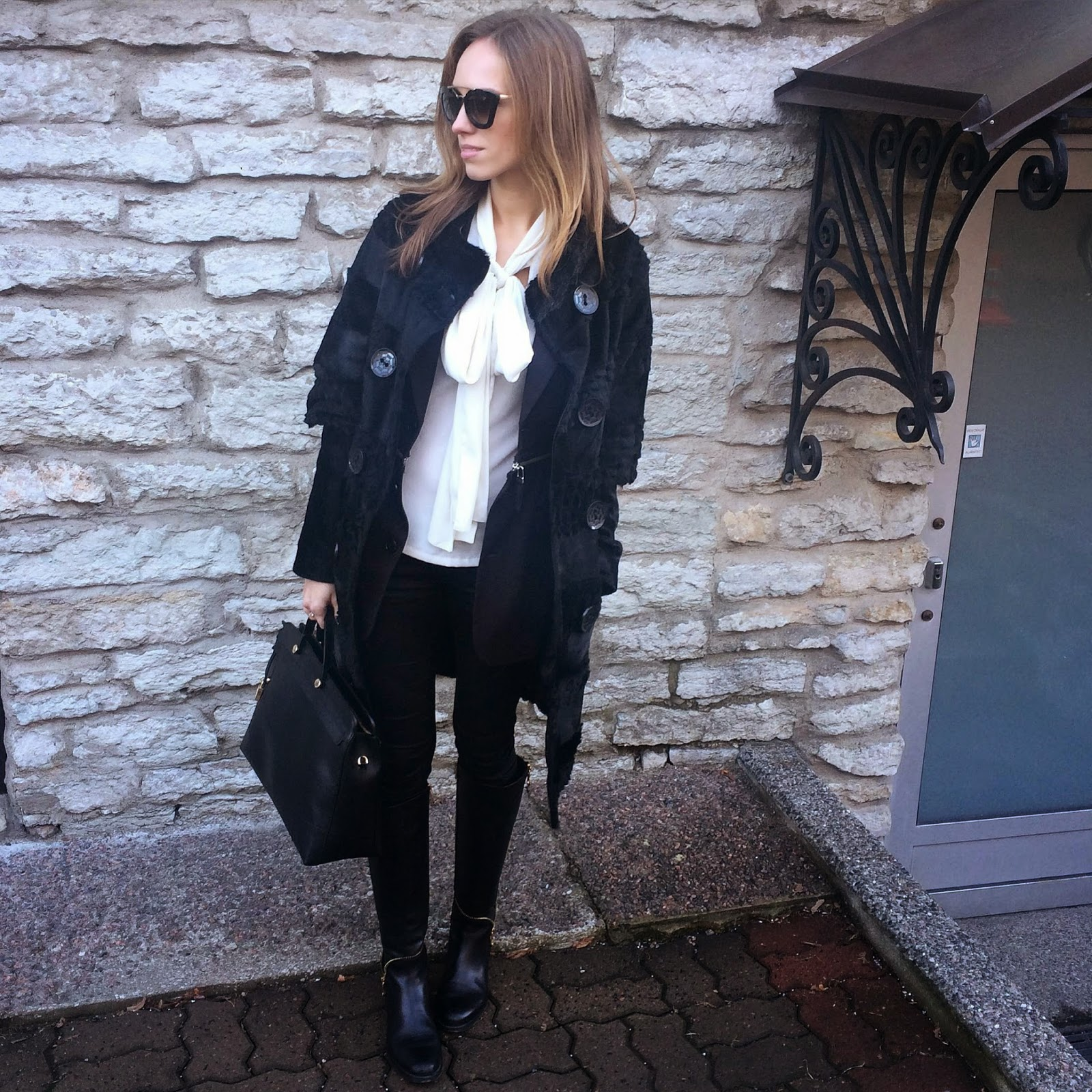 black-fur-coat-white-bow-blouse-black-jeans-knee-high-boots-winter-outfit