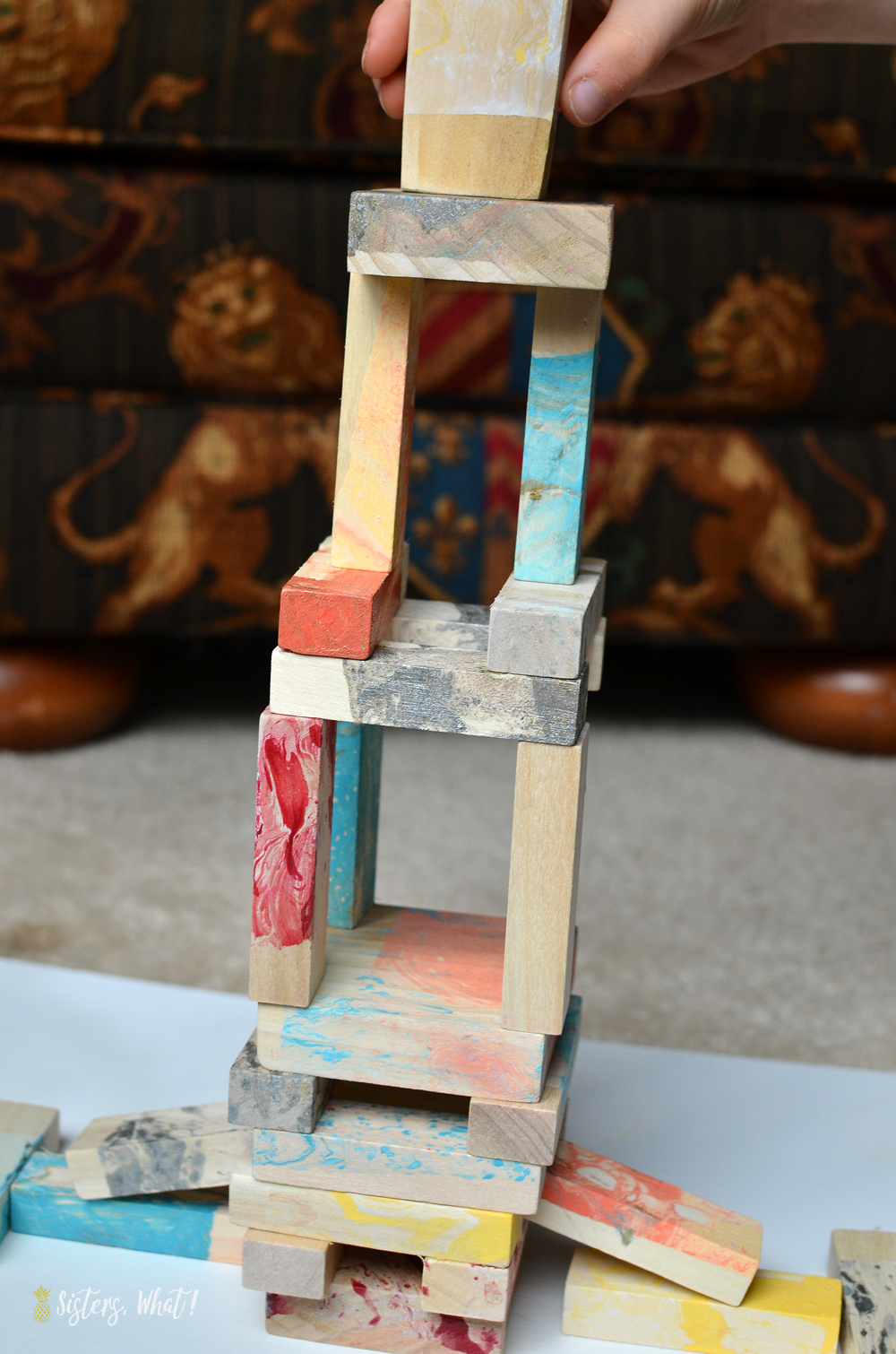 rainbow colorful marbleized painting on jenga wood blocks