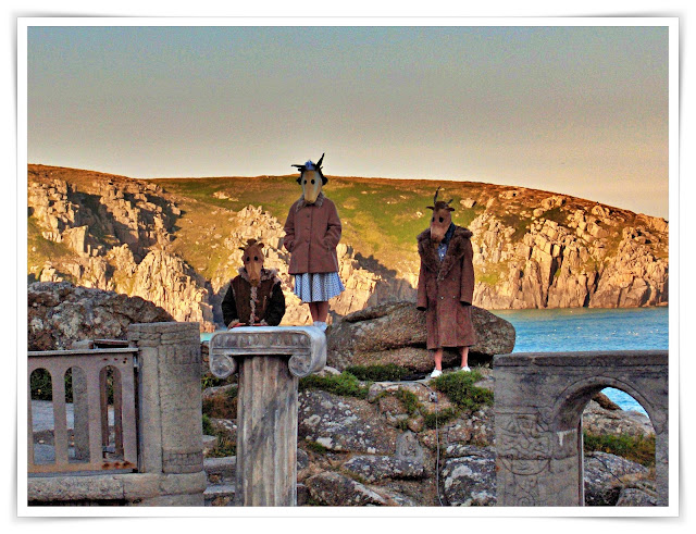 Strange looking people in masks on the cliffs at Minack Theatre, Cornwall