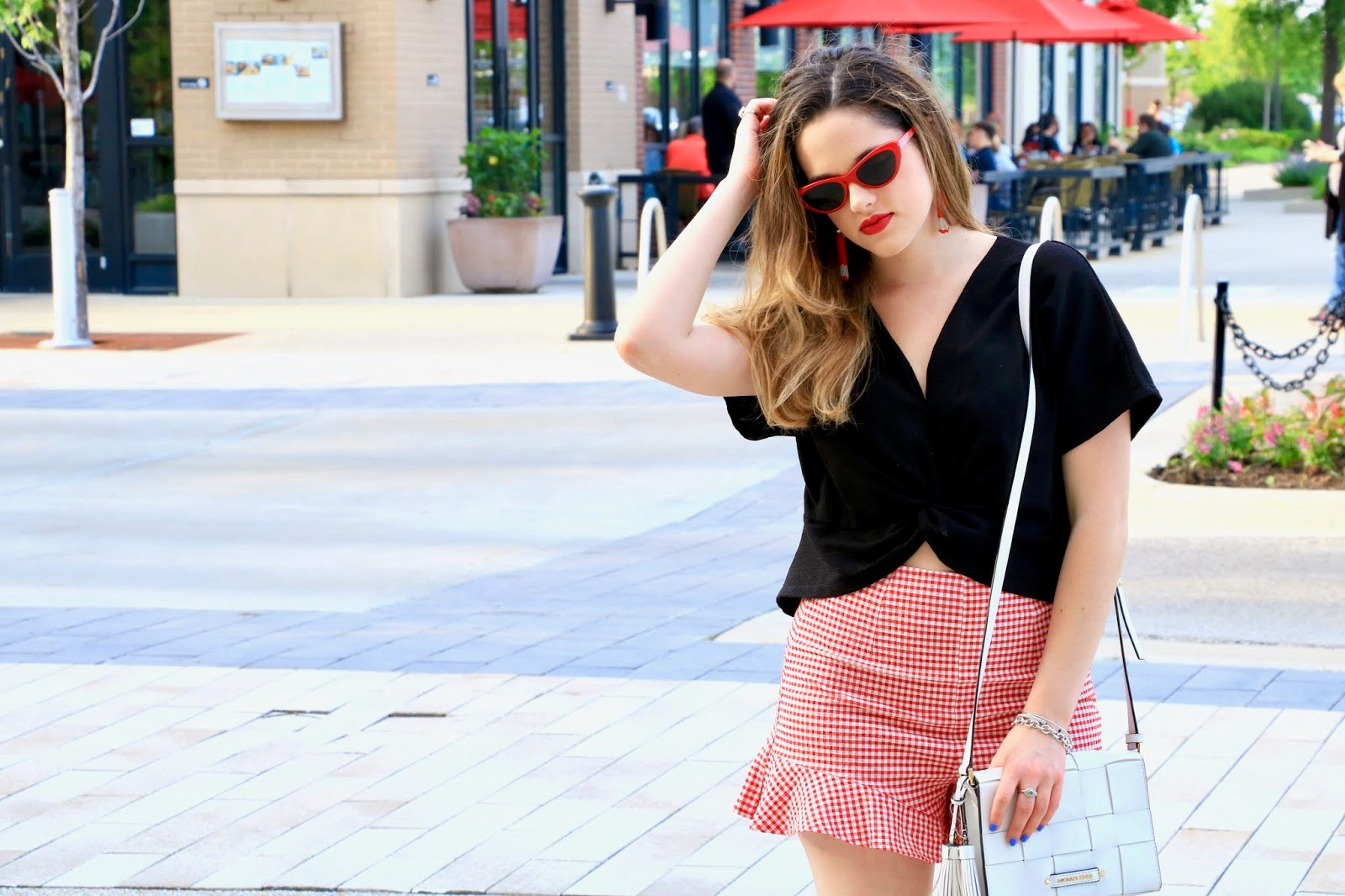 Nyc fashion blogger Kathleen Harper showing how to wear red retro sunglasses
