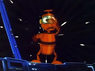 Fotograma con la mascota robot de Ulises 31: Nono. Un simpático robot de color naranja