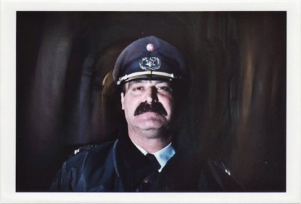 dirty photos - upon - flash street photo of policeman with moustache in lisboa