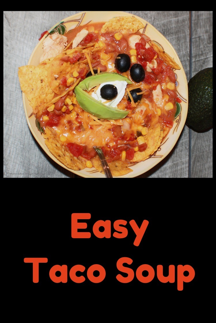 This is bowl of taco soup with sour cream and cheese tortilla, olives, avocado in a thick bean sauce