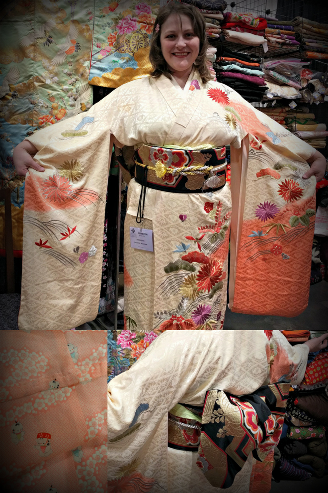 Vendor Tangerine Mountain Imports shows off a kimono at the Sewing and Quilt Expo.