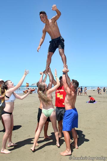 Top: Andrew Hayward, 14, potential recruit, taking part in a membership drive for Bay City Cheerleaders, at Waimarama Beach Day, a MoreFM fundraiser for Waimarama Surf Lifesaving at Waimarama Beach, Waimarama. photograph
