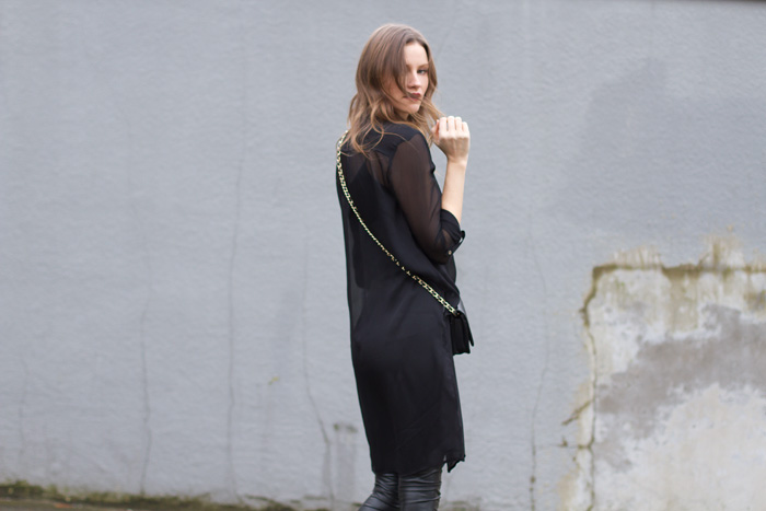 Vancouver Fashion Blogger, Alison Hutchinson, is wearing a black Dynamite Tunic and Aritzia faux leather leggings