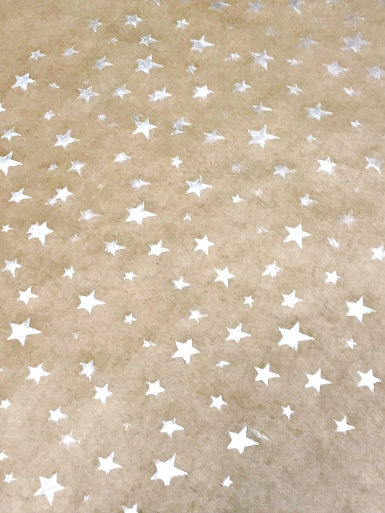 Field of silver stars on gift wrap