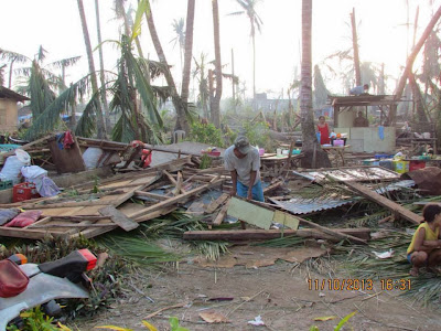 a father salvaging whatever he could from the ruins of Yolanda