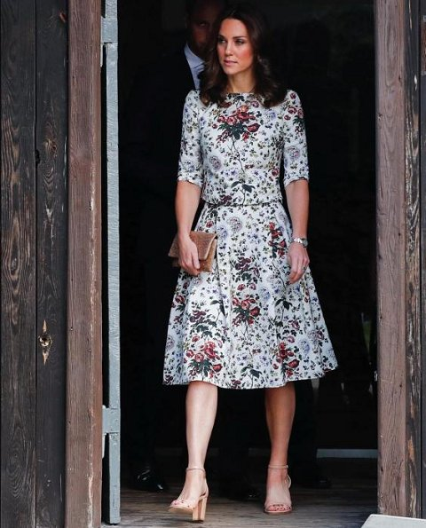 Kate Middleton wore Erdem Imari Hurst Rose Skirt. Catherine, Duchess of Cambridge, Prince William visit Nazi Concentration Camp