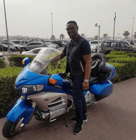 COZA Pastor, Biodun Fatoyinbo Who Posed With a Power Bike Says it's Not his Bike