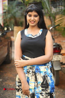 Actress Model Poorni Stills in Floral Long Dress at Silk India Expo Launch  0011.JPG
