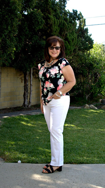 white jeans and black floral top