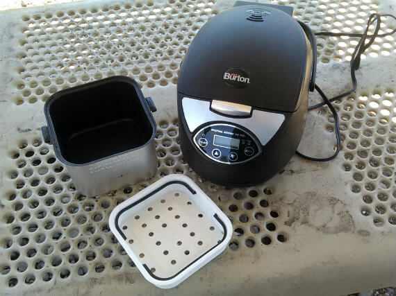 Photo of max burton 12v digital stove to go with non-stick pot and steamer tray outside it. Vanholio.com