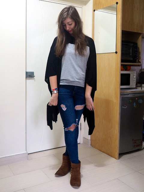 Rough Around the Edges | casual outfit of grey t-shirt, black cape cardigan, ripped jeans and brown ankle boots