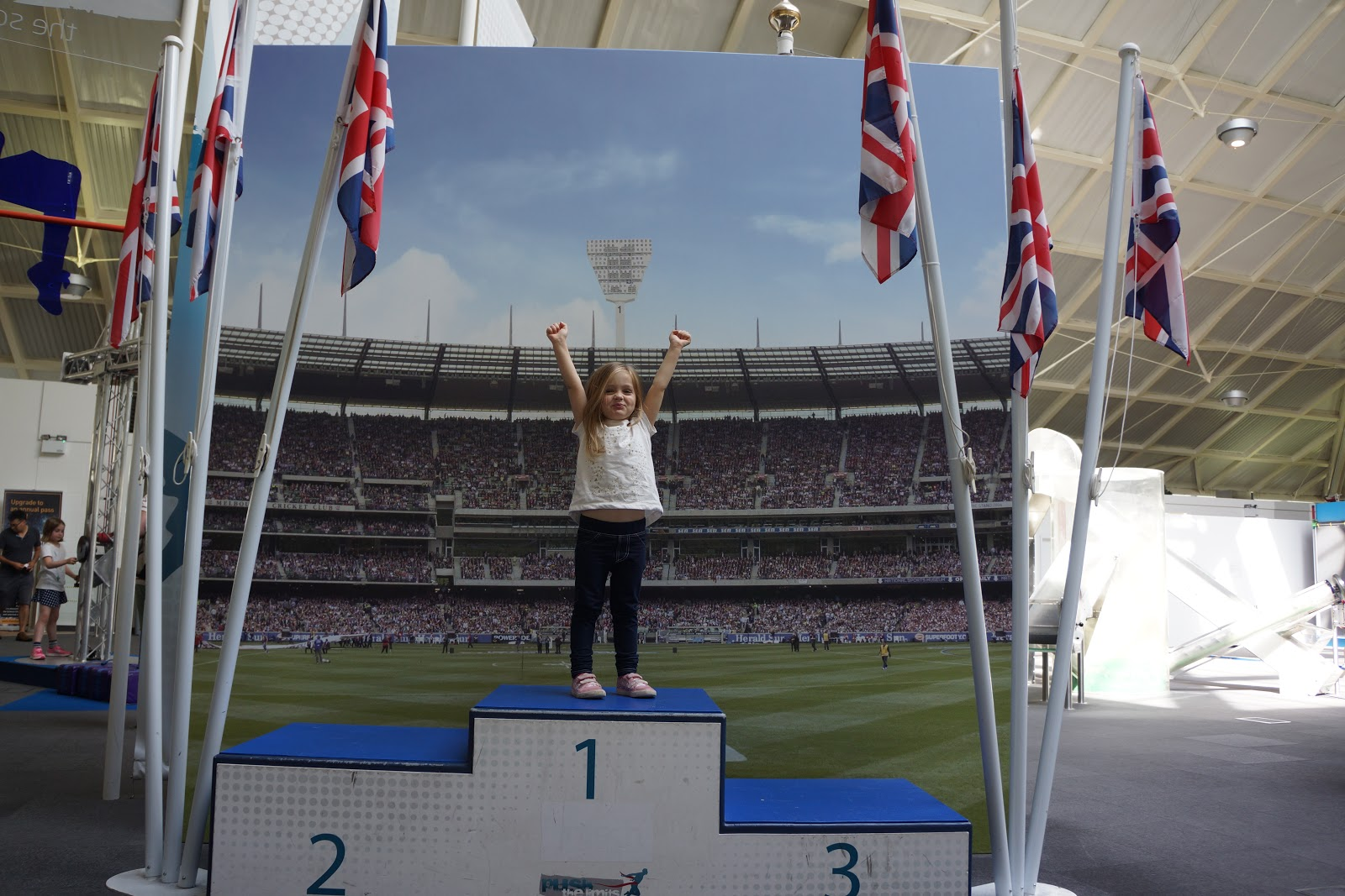 girl standing on a podium in science centre