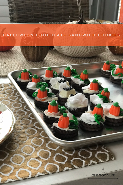 Halloween chocolate sandwich cookies with pumpkins.