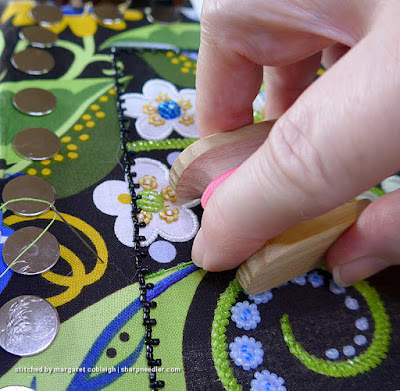 Showing how to hold the koma and feed beads while beading. (Wild Child Japanese Bead Embroidery by Mary Alice Sinton)