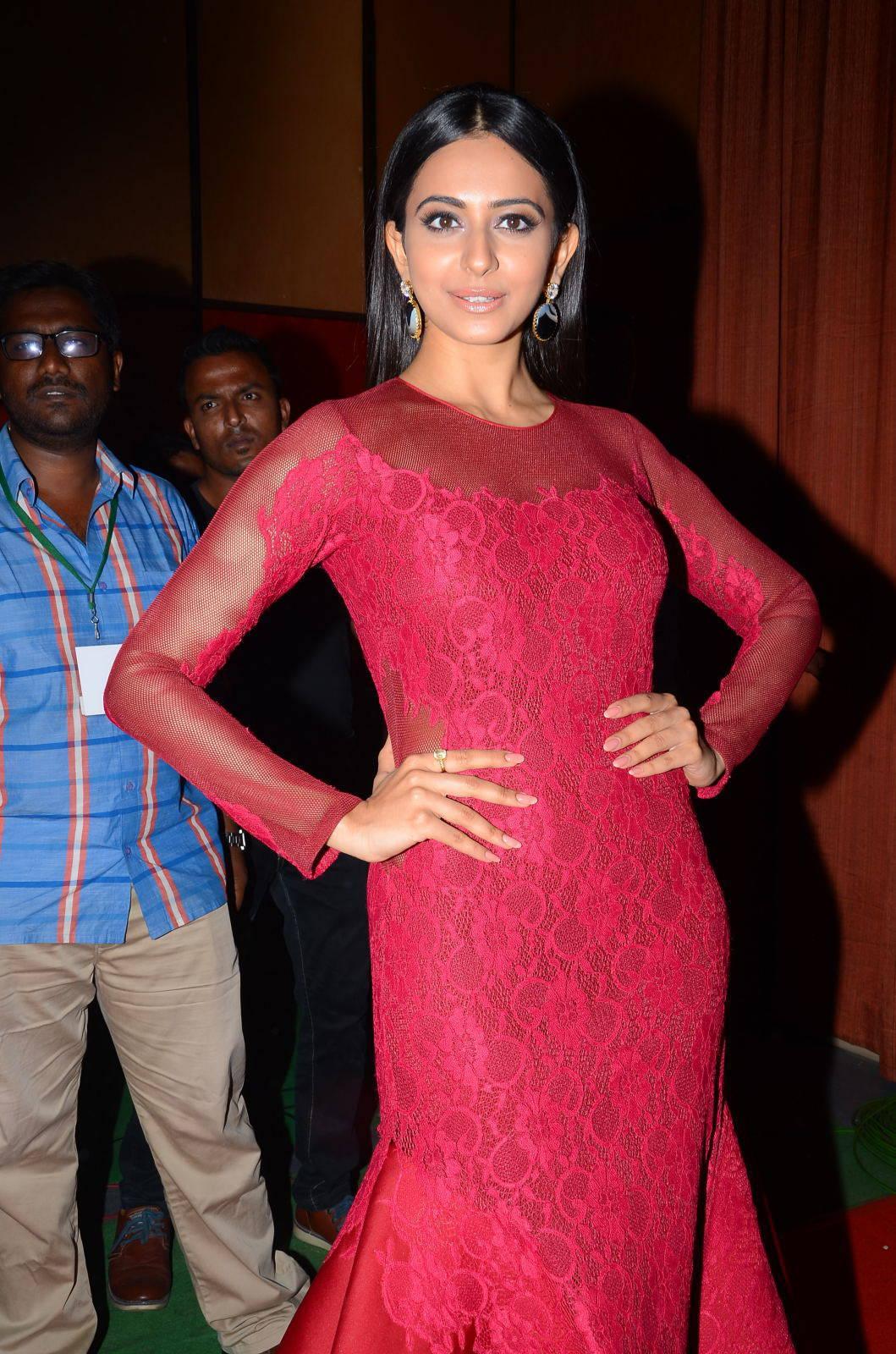 Rakul Preet Singh In Maroon Dress At Film Audio Launch
