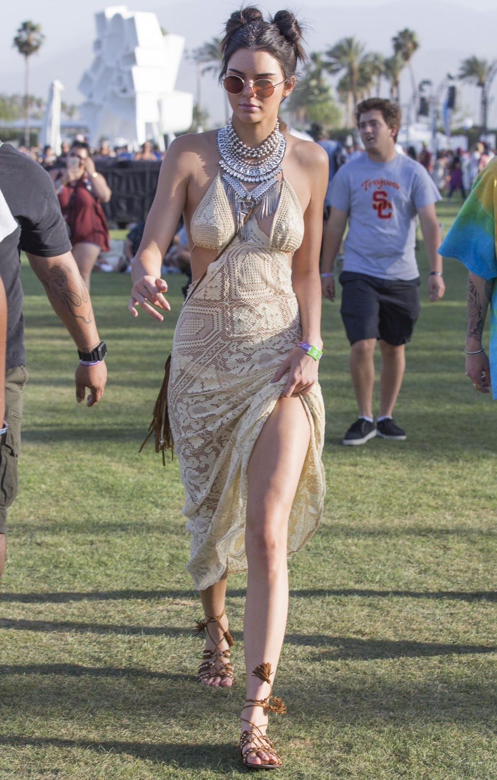 Kendall wears raver bun hairdo and lace dress for Coachella 2016