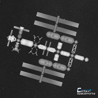 black and white photo of a space ship with lander attached and empty spaces for two more landers