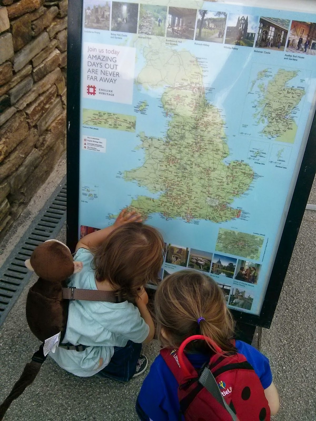 Girls picking a holiday from map
