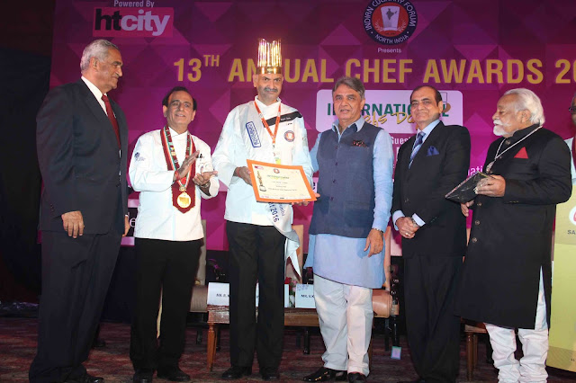 Pic- Mr. Rajan Loomba Sr Executive Chef (The Ashok)receiving award from Shri. V K Duggal