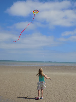 flying kites on the beach om Normandy