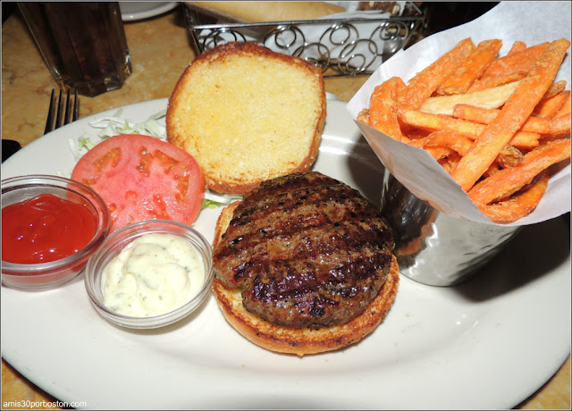 The Classic Burger: A Gigantic Chop House Hamburger. Served with a Slice of Grilled Onion, Lettuce, Tomato and French Fries or Green Salad