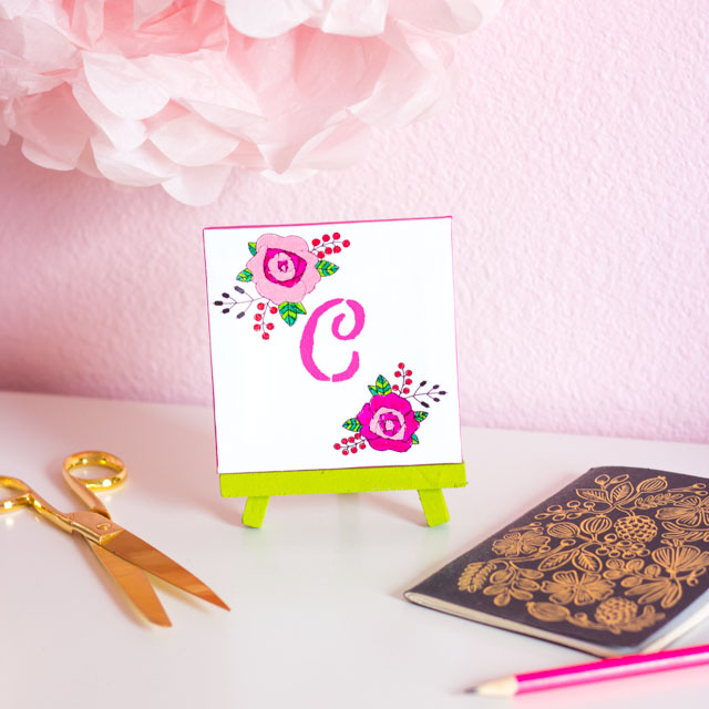 Make this monogram desktop art from mini canvases and floral rub-ons. A perfect personalized Mother's Day or birthday present!