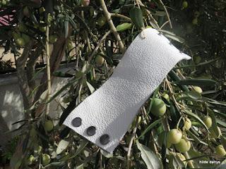 LoveLea's white leather cuff.
