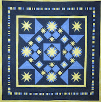 Blue square quilt with yellow stars