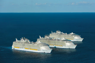 Three Royal Caribbean Oasis-class sister ships at sea