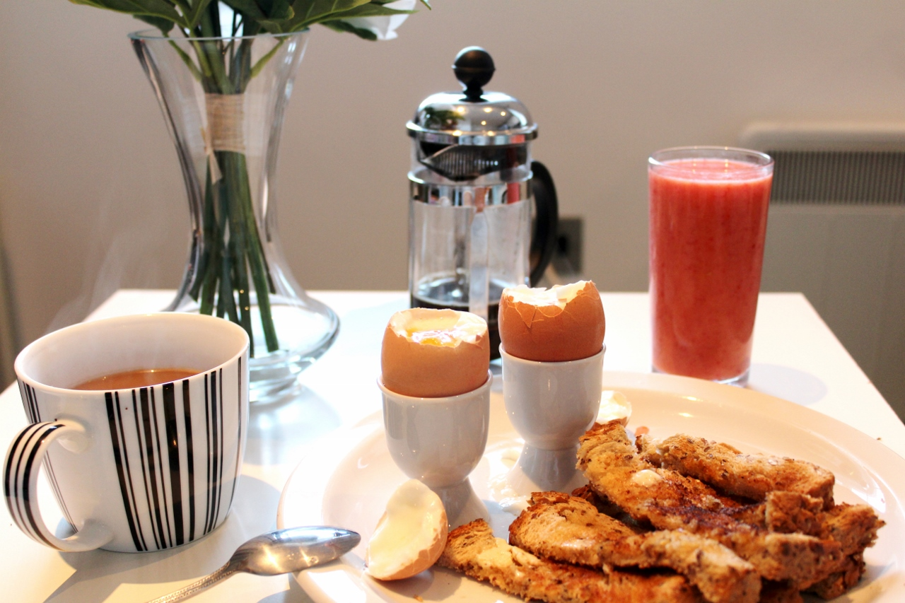 Boiled eggs and toast with coffee and smoothie breakfast