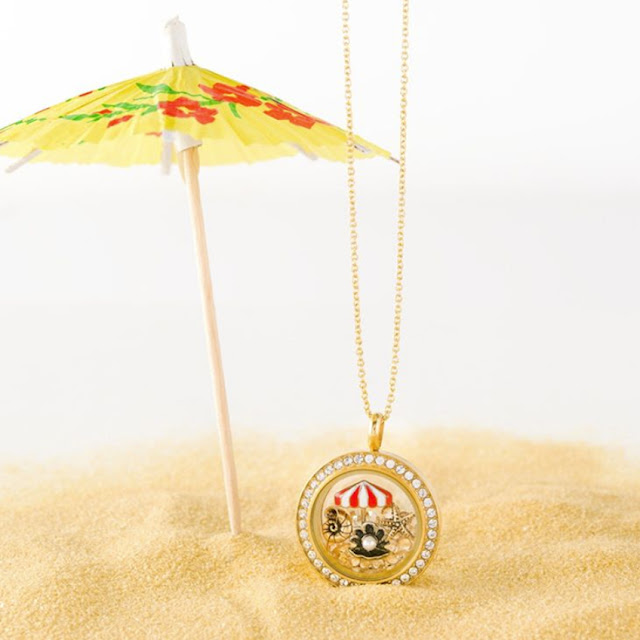 You can almost hear the ocean waves when you fill your Origami Owl Living Locket with beach themed charms. Shop StoriedCharms.com to create your own.
