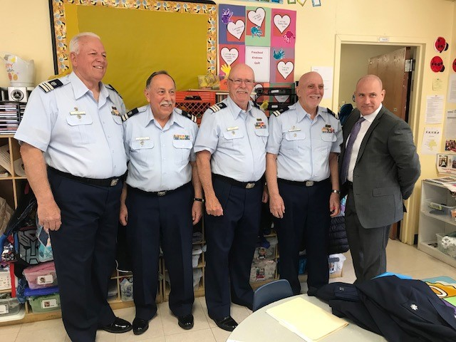 Auxilarists John Fisher, William Castagno, Dennis Georgia, and John Ignozza are all smiles with Vito Buccellato Chief Operations Officer of Ocean Medical Center in Brick, NJ.
