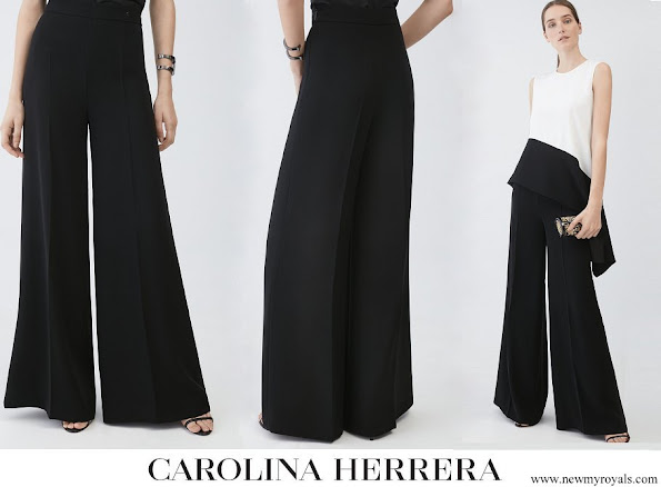 Queen Letizia wore Carolina Herrera black crepe wide leg trousers
