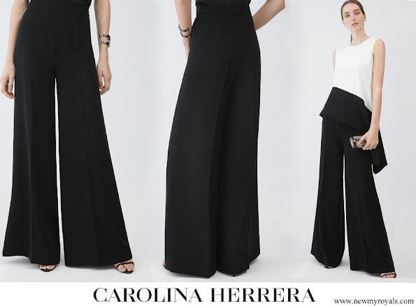 Queen Letizia wore Carolina Herrera black crepe wide leg trousers