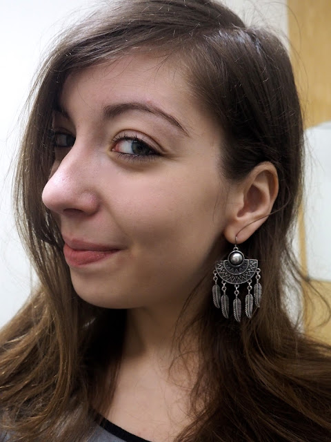 Work in Winter - outfit jewellery details of chunky silver earrings, with half circle and feather design