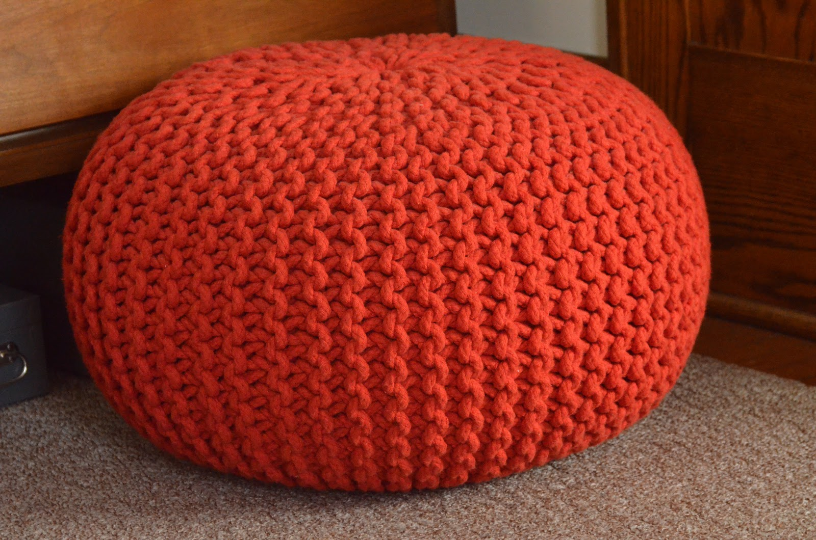 Orange knitted pouf